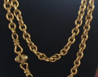 Gold Florentine ribbed chain with pearl and rhinestone attachment circa 1990