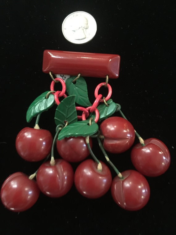 Bakelite and celluloid cherry pin circa1940s