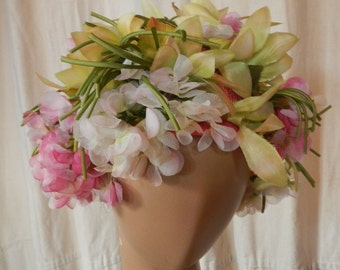 A Christian Dior chapeau of floral motif in pinks and greens and creams,1960s petal drape