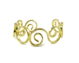 Gold Tone Swirl Cuff Bracelet