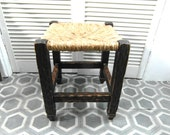 French farmhouse stool with straw seat.