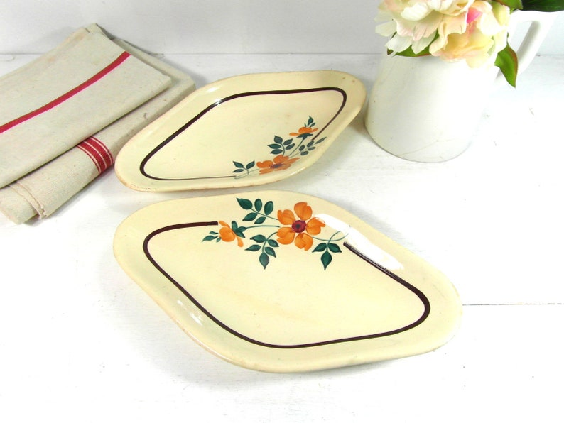 Pair of antique oval serving plates by Moulin des Loups France St Amand