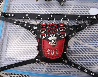 A black and red leather hip bag with razor blades and brass knuckles this is a one-of-a-kind bag