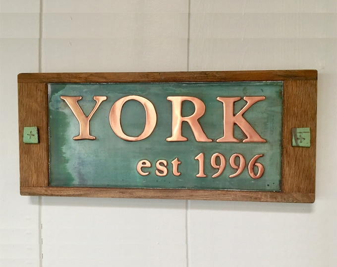 "Family name sign and est xxxx  copper with oak frame 2""/50mm and 1""/25mm high Garamond in UPPER/lower case d"