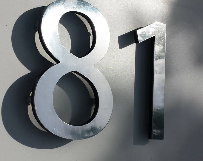 "Polished aluminium modern 3D 6"" high house sans serif numbers in Myriad Pro, marine lacquered with floating standoff g"