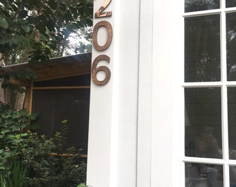 """Large copper floating house numbers  in copper,     6""""/150 mm in Antigoni font, polished and lacquered  with locator fittings d"""