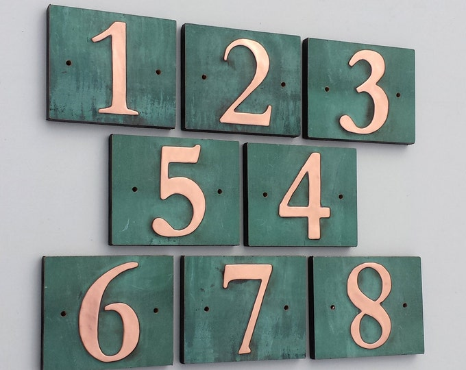 "Traditional house number green copper on plywood back, 3""/75mm, 4""/100 mm, with real patina, in Garamond d"