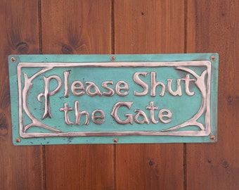 Please Shut the Gate plaque in polished, laquered and patinated copper fixed with rosehead nails or brass screws