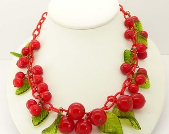 ON SALE Cherry Bakelite Celluloid Necklace Green Glass Leaves