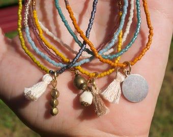 Set of Seven Bracelets with Tassels