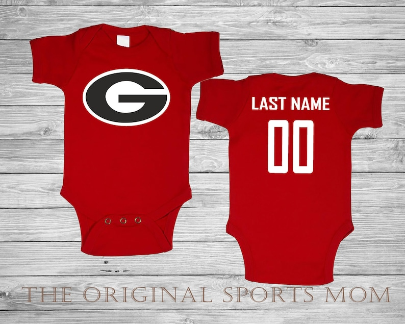 sale retailer ca561 bd1e2 Personalized Georgia Bulldogs Jersey Style Baby One Piece/Bib.  Football/Sports. Perfect as a Babyshower Gift!