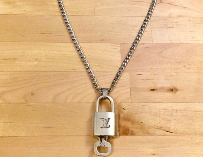 a5f24df70cb90 Super Rare 100% authentic Silver Louis Vuitton Lock with Silver Stainless  Steel Chain Necklace