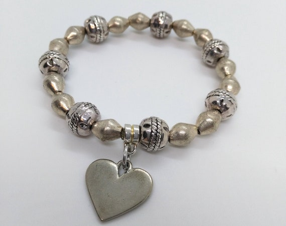 Beaded Stretch Bracelet with Ethnic Metal Beads in Antique Silver, Ethiopian Bicone Beads and Heart Charm in Pewter