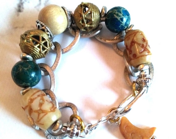 Gemstone Beaded Bracelet in Blue Emperor Stone, African Brass, Carved Jade, Amber Serpentine Crescent and Aluminum Chain