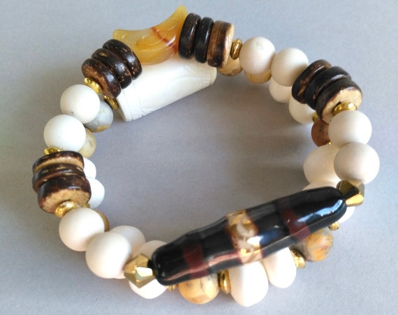 Gemstone Beaded Stretch Bracelet in Earthy Colors with Beige Fossil Beads, Wood Rondelles, Kazuri Bead, and Carved Serpentine Crescent