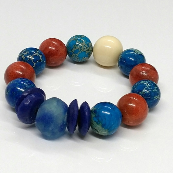 Beaded Bracelet in Blue, White and Red with Creamy Tagua Focal Bead, Natural Emperor Jasper Stone, Sponge Coral and African Recycled Glass