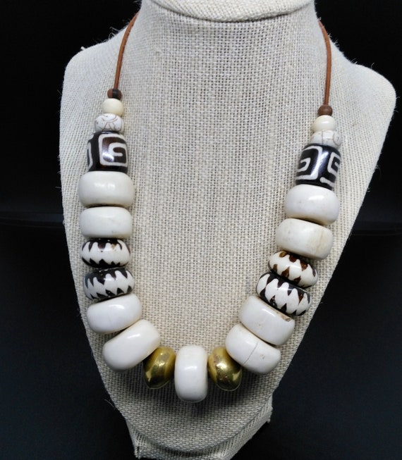 Bone Bead Necklace with African Dark Brown Batik Bone Beads, White Bone, Brass Saucer Beads, Howlite, Raw Ebony and Cream Ox Bone