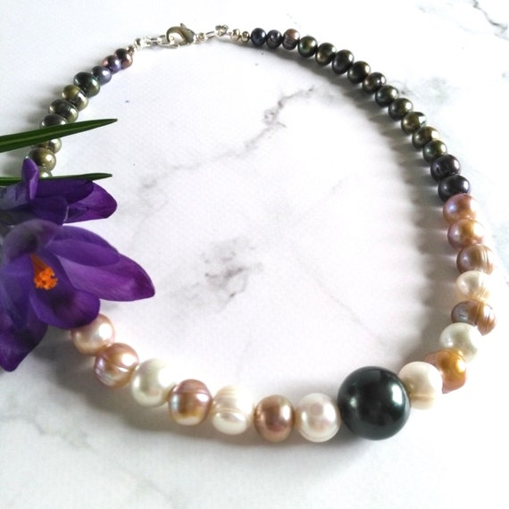 Pearl Necklace with Freshwater Pearls in Varying Sizes of Cream and Earth Tones with Large Green Focal Bead