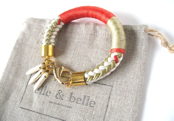 Nautical Bracelet in Beige Boating Cord with Gold End Caps, Lobster Clasp and Howlite Dagger Charms is Wrapped with Red and Beige Trim Cord