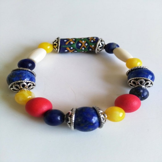 Colorful Beaded Bracelet in Blue, White, Yellow and Red with Lapis Lazuli, Sodalite, Bone, Africa Glass, Resin and Wood