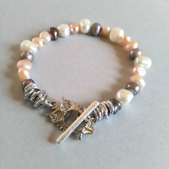 Stackable Pearl Bracelet in White, Pink and Gray Freshwater Pearls is Easily Stacked  with Other Bracelets in Our Collection