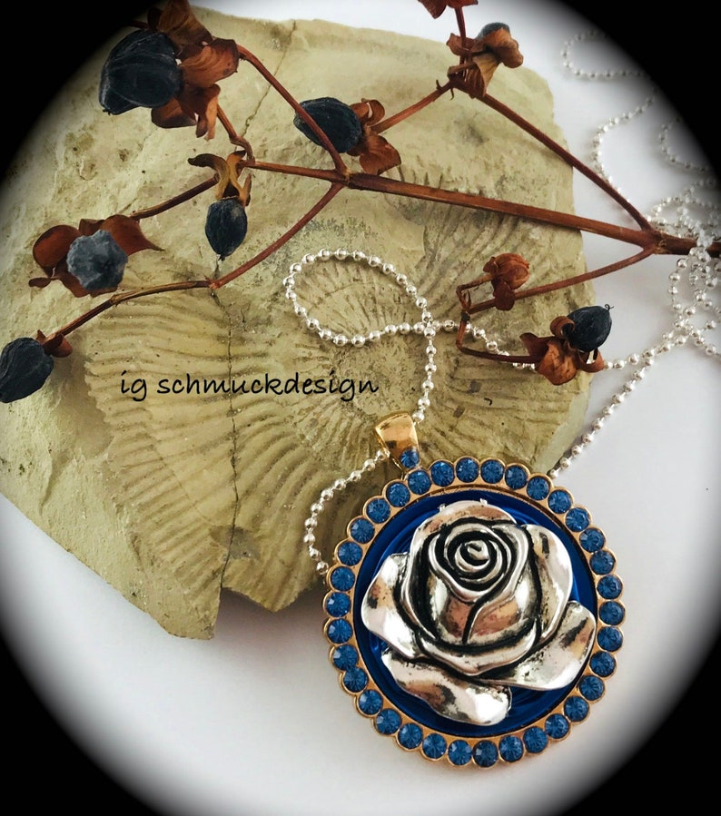 A beautiful rose with a glass beads glitter band on Nespresso image 0