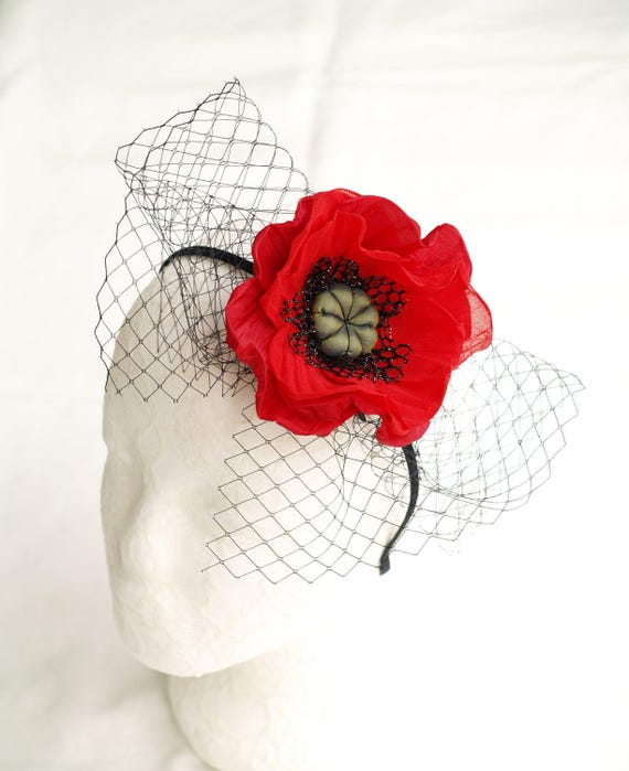 Poppy red fascinator headpiece with floral pearl detail