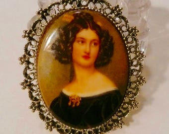 Vintage Brooch With Gold-Tone Setting And Portrait Of Woman On A Transferware Glass Oval