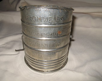 Vintage Bromwell's measuring sifter with measurments printed on sifter - capacity three cups.