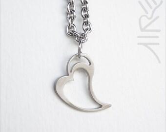 Heart charm bracelet by Marsh Scott. 7.75 inches, stainless steel.