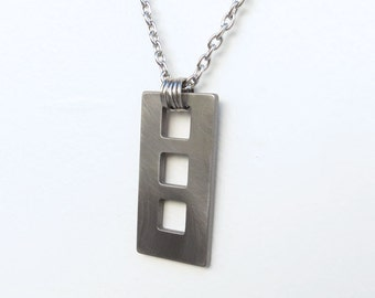 Three Windows necklace by Marsh Scott. Stainless steel with a 17 inch chain and lobster clasp.
