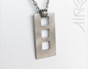 Three Windows necklace by Marsh Scott. Stainless steel with a 20 inch chain and lobster clasp.