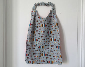 Napkin, canteen napkin, elasticated neckline napkin, kindergarten bib, fish, grey background, back to school