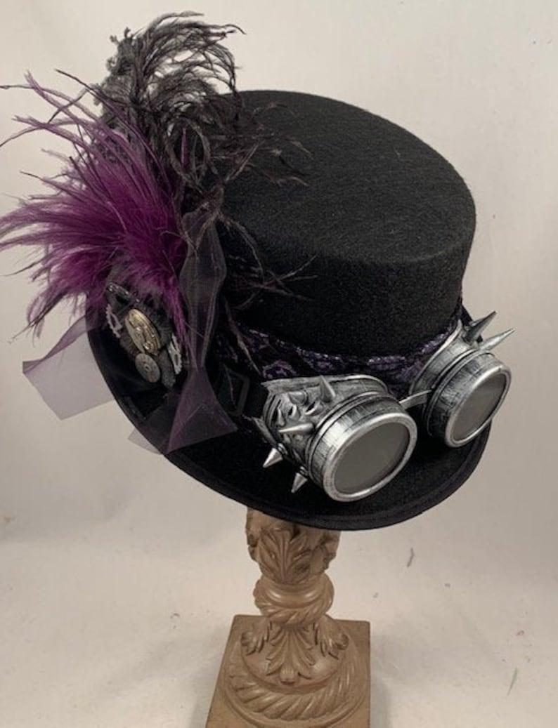 Steampunk Accessories | Goggles, Gears, Glasses, Guns, Mask     Steampunk Top Hats Stempunk Shop Steampunk Attire Steampunk Wedding Black Purple Ostrich Silver Goggles $89.00 AT vintagedancer.com