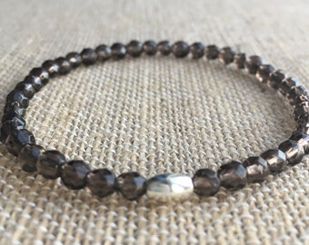 4mm faceted Smokey Quartz stretch bracelet with sterling silver tube bead