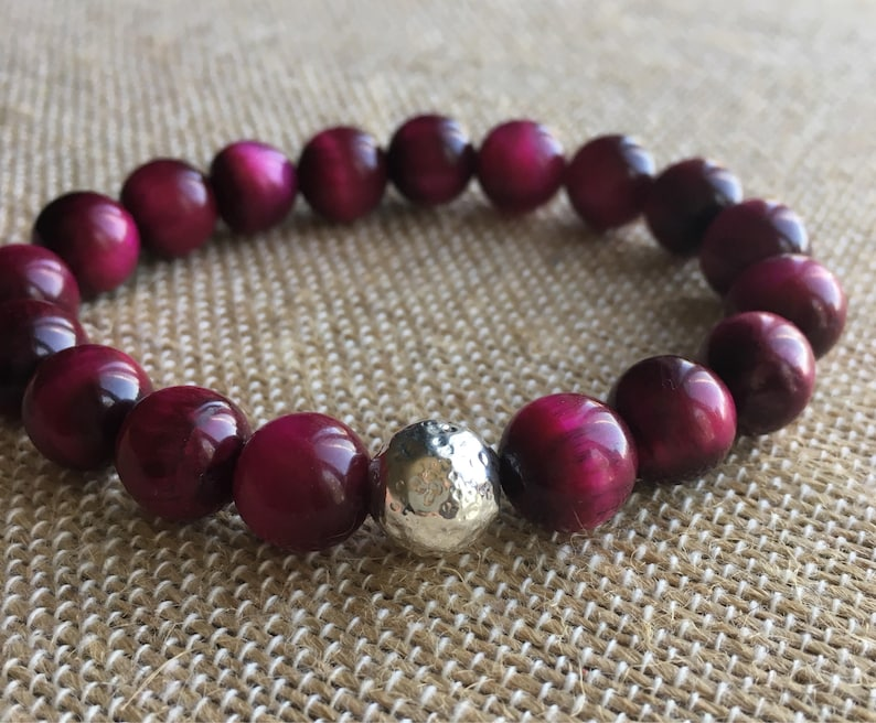 10mm Magenta Tiger Eye stretch bracelet with a hammered Sterling Silver Bead