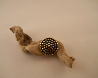 BUTTONS: Black button with gold bumps.  3/4 inch.  Domed.  Shank.