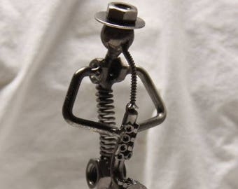 Miniature saxophone player novelty figurine.  All metal