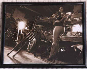 16x20 inch framed poster of a curvy beauty with tattoos in a chopper shop
