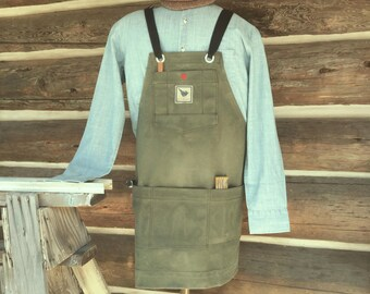Waxed filter twill canvas woodshop apron with adjustable crossed straps. Heavy, durable apron for a woodworker.
