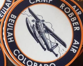 Two Camp Robber Air stickers featuring the DeHavilland Beaver float plane