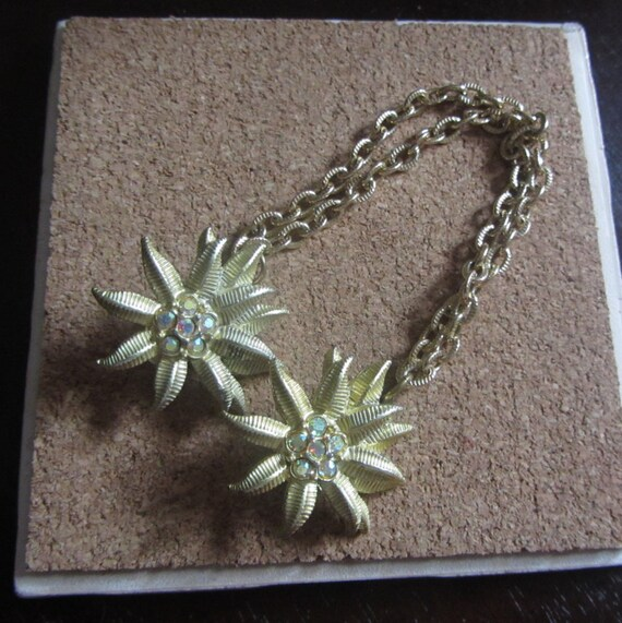 1950s gold flower sweater guard | 50's mid century
