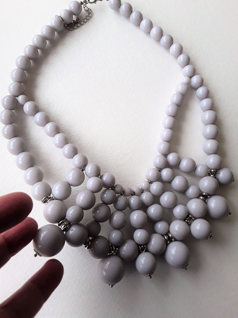 gorgeous multi string beaded lilac bib plastic necklace Necklace