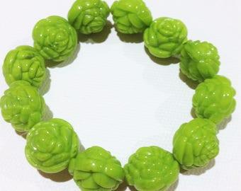 Bracelet  - lime green moulded roses plastic bracelet floral design