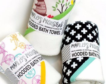 HOODED BATH TOWEL. Bamboo & organic cotton blend fleece with flannel hood. You choose prints