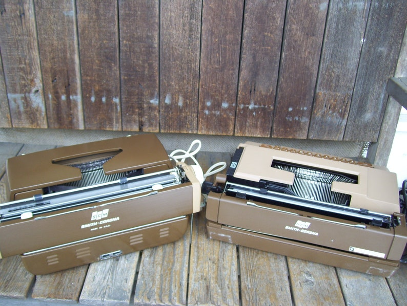 Smith Coronet Electric Typewriter Automatic 12 Wood Grain Or Smith Corona Sterling Cartridge Portable Typewriter Tan Brown Both Have Cases
