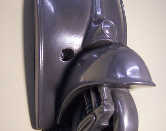 Scooter wall mounted bottle opener.