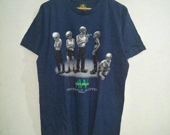 cfed1a82d538 Vintage Alien Wear T-Shirt Logotel Ck Parody