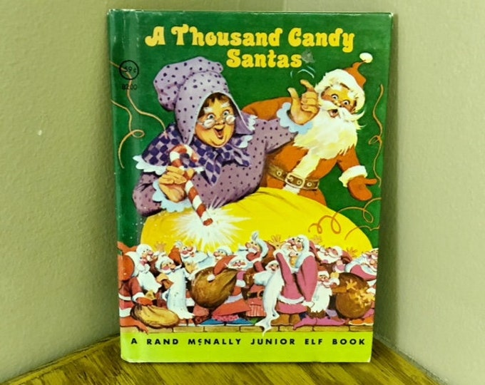 1977 A Thousand Candy Santas A Rand McNally Junior Elf Book