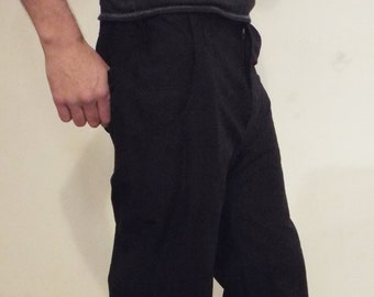 Black baggy alternative / futuristic / cyberpunk / rivethead trousers with double front pockets